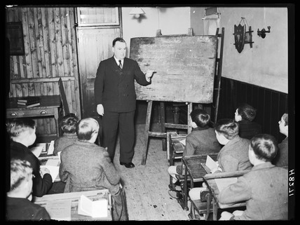 Headteacher in a classroom, 29 December 1939.