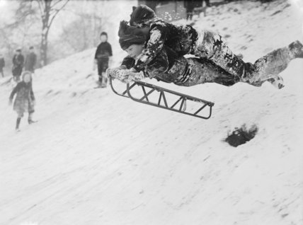 Children tobogganing, 1945.
