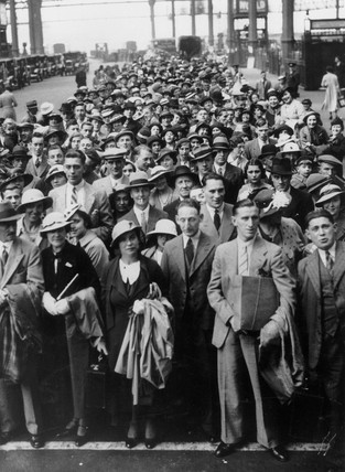 Crowds waiting to board trains for their holidays, Waterloo station, 26 July 1936.