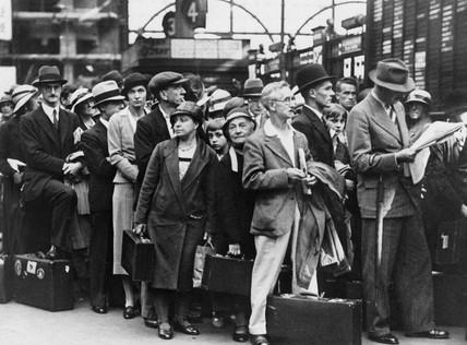 Passengers waiting at Waterloo station, London, 1930s.