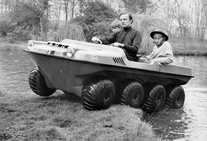 Man with two boys in amphibious vehicle, 22 April 1971.