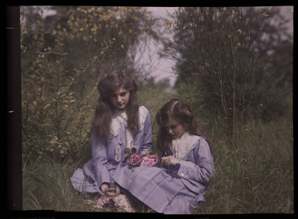 Two girls in a field, 1908.
