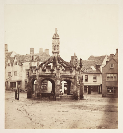 Market cross in a village square, Sussex, c 1860.