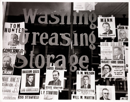 'Campaign Posters in Garage Window, c 1939.