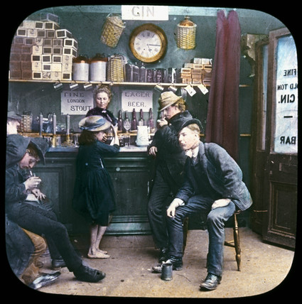 Men and child in a bar, c 1895.