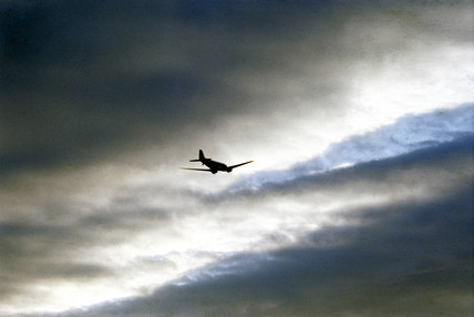 A plane in the sky.