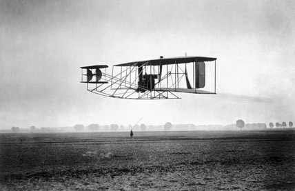 A Wright biplane in flight, c 1905.