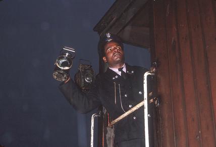 Guard showing right away light, Bishopsgate, London, July 1962.