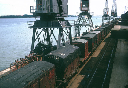 Train of containers on quay, Rotterdam, Netherlands, July 1962.