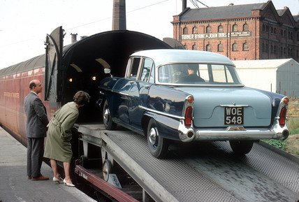 Car being loaded on train, 1962.