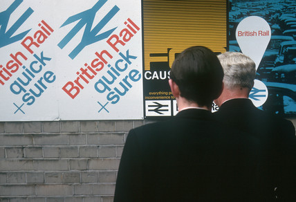 Two men looking at  British Rail posters, April 1964.