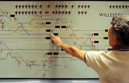 Signalman operating push buttons on illuminated track, December 1966.