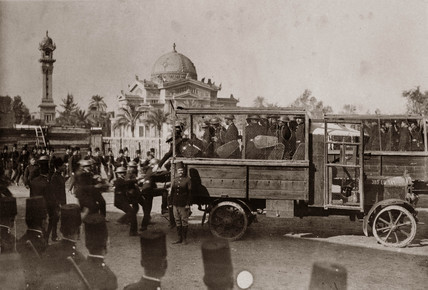 Police on wire-caged lorry during student riots, Egypt, 8 March 1928.