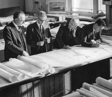 Sir John Brocklebank (left) discuses Q4 plans with colleagues, 21 January 1964.