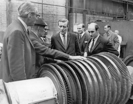 Tony Benn being shown a turbine rotor for the QE2, 11 February 1969.