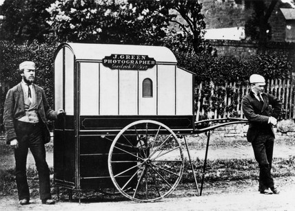 Itinerant photographer with travelling van, c 1874.
