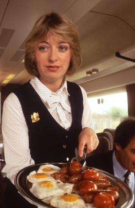 Pullman stewardess with breakfast platter, c 1980s.