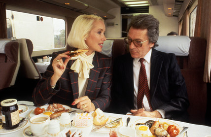 Executive passengers eating breakfast in Pullman dining car, c 1980s.