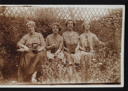 Four women with Kodak cameras, including Brownie cameras, c 1900s.
