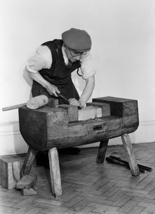 The making of ships' blocks by hand, using a clave, c 1950.