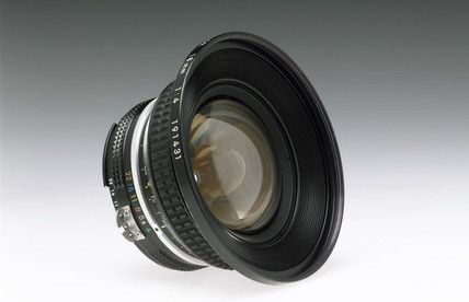 Nikkor 17mm F4 bayonet fitting wide angle lens for 35mm camera, c  1980s.