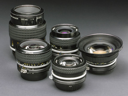 Selection of Nikkor bayonet fitting lenses for 35mm camera systems, c 1980s.