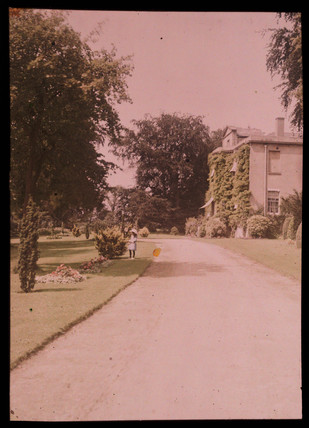 Autochrome of a house and garden, c 1910.