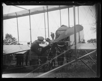 'Pilot Inspecting aeroplane Propeller', c 1910.
