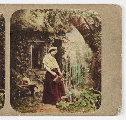 Woman watering plants, c 1870.