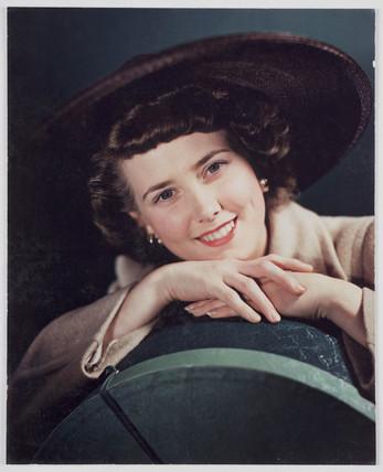 Woman modelling a hat, c 1940s.