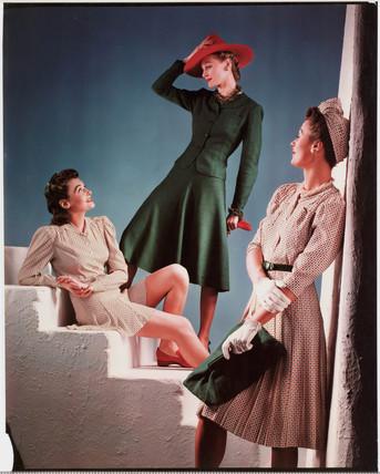 Three women modelling the latest fashions, c 1940s.