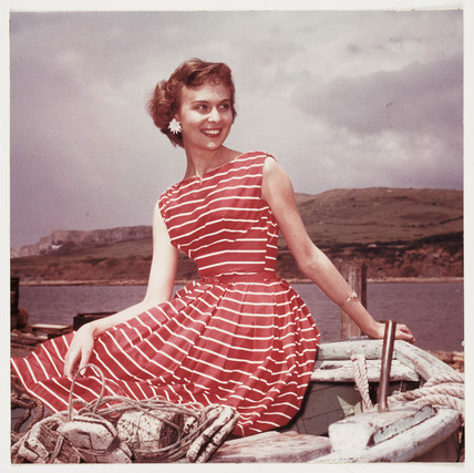 Woman wearing a summer dress, c 1950s.