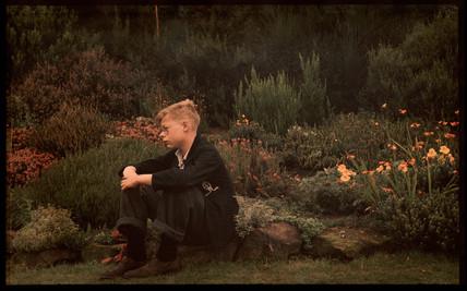 Boy in a garden, c 1940.