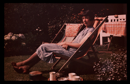 Woman in a deckchair, c 1935.