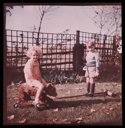 Children playing in a garden.