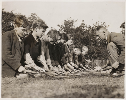 Children clipping a lawn, 4 November 1933.