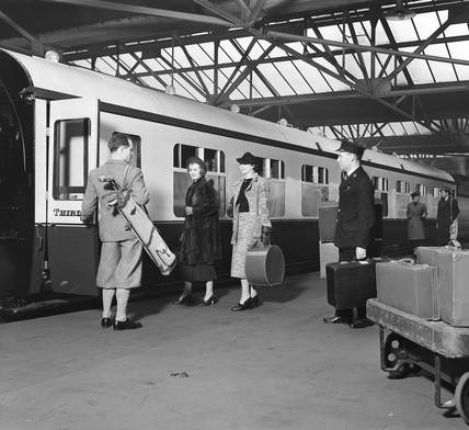 Passengers boarding a train, 1936.