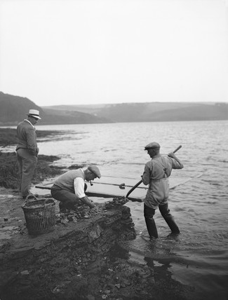 Oyster fishers watched by a tourist, Percuil, Cornwall, 1937.