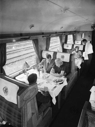 Passengers in a first class Great Western Railway dining car, 1938.