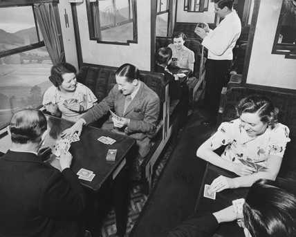 Passengers playing cards in a third class carriage, February 1938.