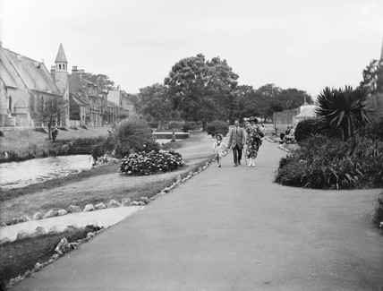 A family walking through a park in Dawlish, Devon, August 1921.