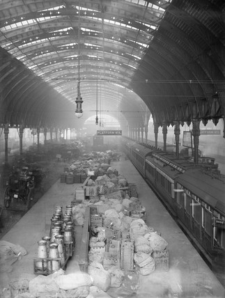Milk churns and mail sacks at Paddington Station, London 1908.