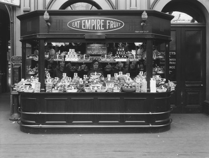Empire fruit stall at Paddington Station, London, 15 July 1927.
