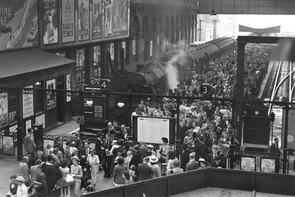 Passengers leaving a train at Liverpool Street station, London, 29 June 1949.
