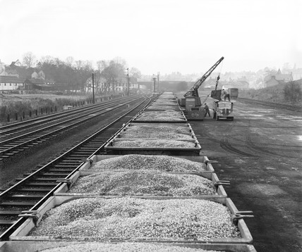 Stone waiting to be unloaded, Stansted goods yard, Essex, 1954.