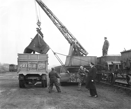 Workers unloading stone, Stansted goods yard, Essex, January 1954.
