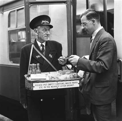 Refreshment seller at King's Cross station, London, 18 December 1953.