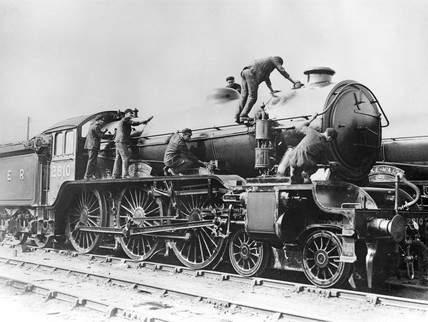 Locomotive being cleaned, c 1935