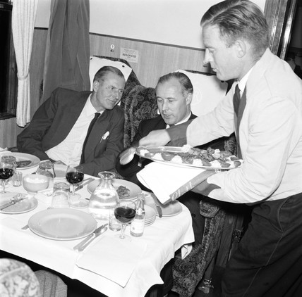 Waiter serving first class passengers on the 'Hook Continental', 20 June 1961.
