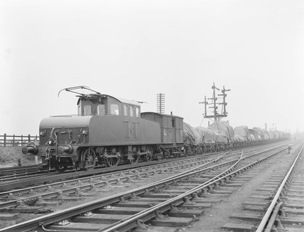 Electric locomotive with a goods train at Aintree, 1912